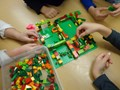 Students making Lego houses
