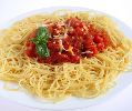 Spaghetti with sprig of basil