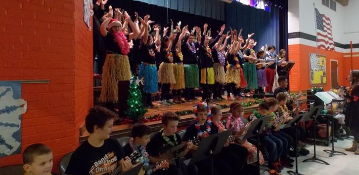 Christmas Choir concert with leis and grass skirts