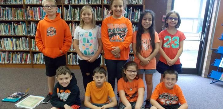 students wearing black and orange