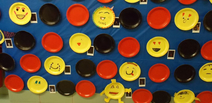 Fun paper plate emoji display for Parent Night