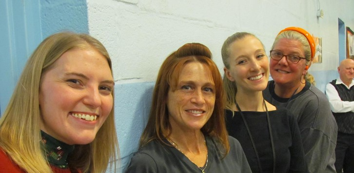 Four teachers smile at the pep rally
