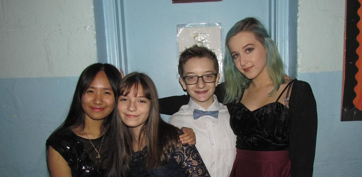 Four students at the Winter Formal