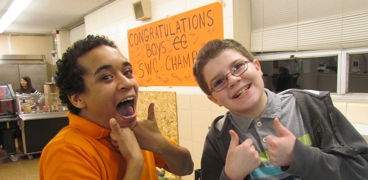 Two male students give the thumbs up