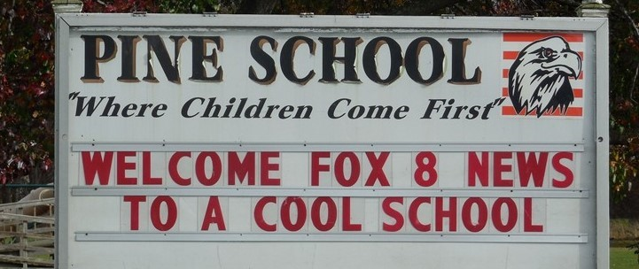 Pine is Cool School sign