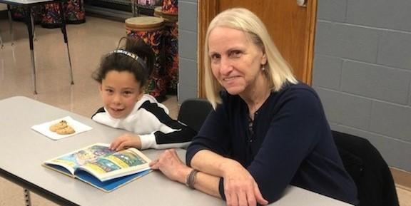 Students reading with Volunteers