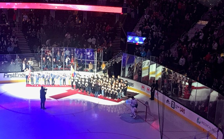 Students Singing National Anthem at Monsters Game